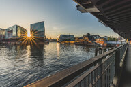 Germany, Hamburg, View to Ericusspitze and Deichtorhallen from Oberhafenbruecke at sunset - KEBF00824