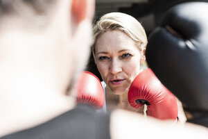 Man and woman in boxing training - UUF13625