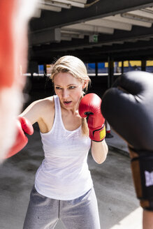 Man and woman in boxing training - UUF13628