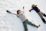 Children making snow angels - ISF00726