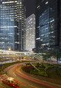 China, Hong Kong, High-rise buildings and taxi at night - MKFF00385