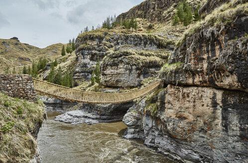 Inca rope bridge crossing river ravine, Huinchiri, Cusco, Peru - CUF02272