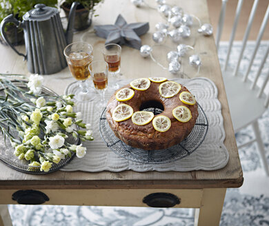 Table with bundt cake, flowers and drinks - CUF02368