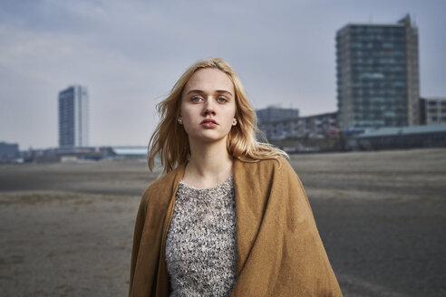 Netherlands, Zandvoort, portrait of blond young woman on the beach - MMIF00052