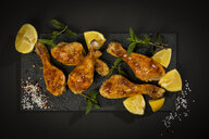 Baked chicken legs on slate, lemon - MAEF12580