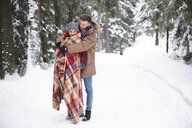 Young couple hugging in snow - CUF02574