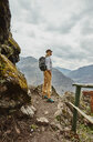 Female hiker looking out at distant mountains, Pisac, Cusco, Peru - CUF02592