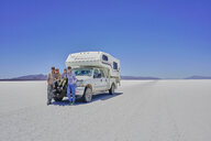Portrait of family, standing in front of parked recreational vehicle, Salar de Uyuni, Uyuni, Oruro, Bolivia, South America - CUF02604