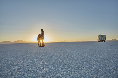 Mother and son standing on salt flats, looking at view,  Salar de Uyuni, Uyuni, Oruro, Bolivia, South America - CUF02610