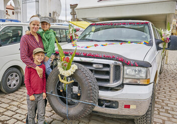 Portrait of mother and sons beside recreational vehicle, Copacabana, Oruro, Bolivia, South America - CUF02616