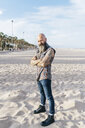 Mature male hipster standing on beach, portrait, Valencia, Spain - CUF02679