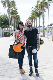 Portrait of mature hipster couple on sidewalk, Valencia, Spain - CUF02685