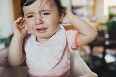 Portrait of crying baby girl at home - GEMF01957