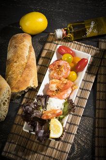Antipasti, tuna, salad, filled paprika, white beans, black olive, shrimp, sour cream, tomato and white bread - MAEF12583