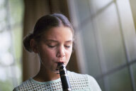 Young clarinettist playing her clarinet - CUF02833