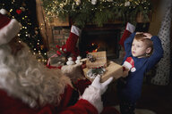 Young boy receiving gifts from Santa - CUF03130