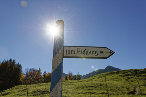 Germany, Bavaria, Upper Bavaria, sign post, exit of an open air mseum against the sun - LHF00562