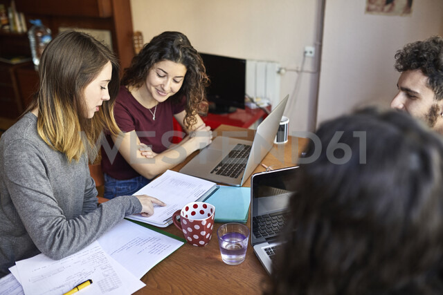 Four students at desk working and learning together - JRFF01621