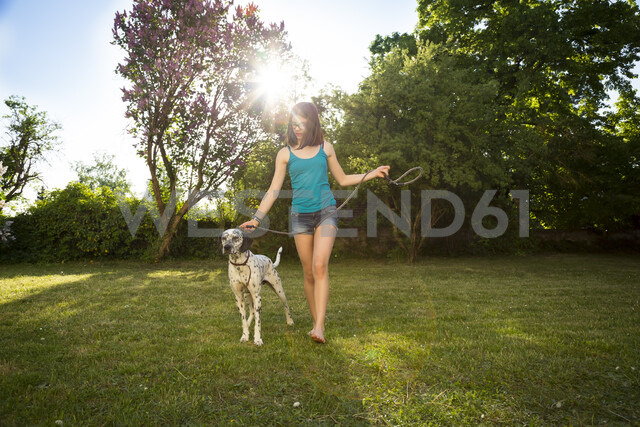 Girl with Dalmatian in the garden - LVF06963