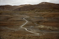 Distant landscape of winding valley road and mountains, Iceland - CUF03881