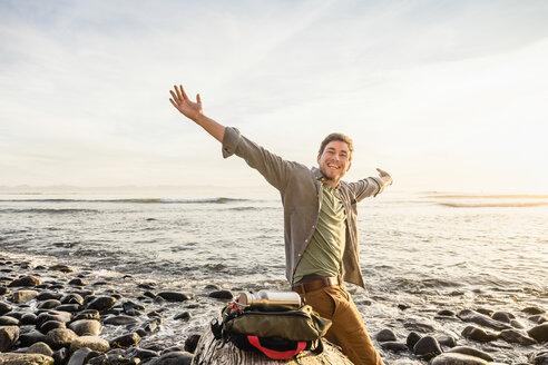 Portrait of happy man on beach in Juan de Fuca Provincial Park, Vancouver Island, British Columbia, Canada - CUF04079