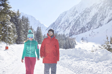 Couple walking in snow-covered landscape - CVF00479