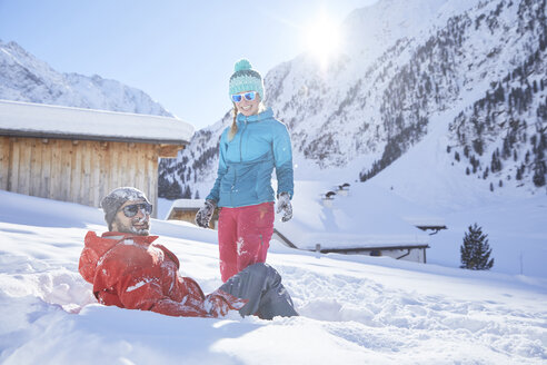 Active couple having fun in snow-covered landscape - CVF00488
