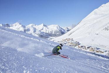 Austria, Tyrol, Kuehtai, man skiing in winter landscape - CVF00500