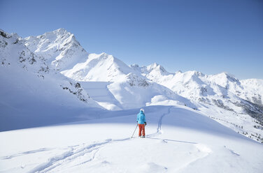 Austria, Tyrol, Kuehtai, female skier in winter landscape - CVF00503