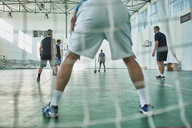Men playing indoor soccer - ZEDF01414