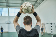 Close-up of indoor soccer player throwing in the ball - ZEDF01417