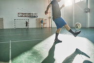 Indoor soccer player balancing the ball - ZEDF01423