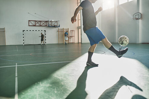 Indoor soccer player balancing the ball - ZEDF01423