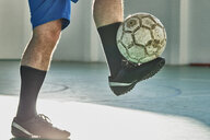 Indoor soccer player balancing the ball - ZEDF01426