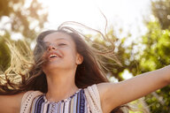 Teenage girl enjoying the breeze - CUF04685