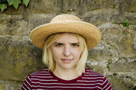 Portrait of young blonde woman with sun hat - FLLF00038