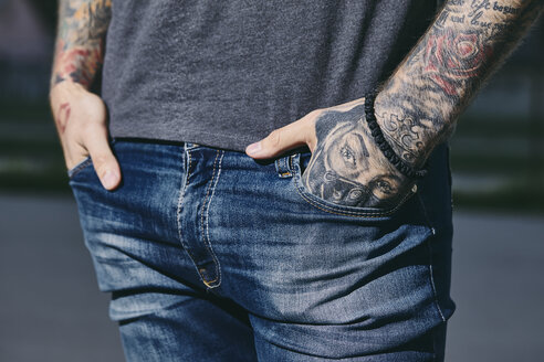 Tattooed arms of a young man outdoors - ZEDF01459