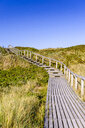 Germany, Schleswig-Holstein, Sylt, wooden walkway through dunes - EGBF00259