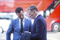 Businessmen in street talking, London, UK - CUF04893