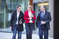 Businesspeople walking in street - CUF04902
