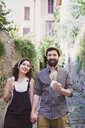 Portrait of couple with ice cream cones on cobbled street, Arezzo, Tuscany, Italy - CUF05149