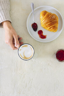 Overhead view of woman with milky coffee, croissant and jam - CUF05194