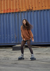 Portrait of young inline-skater at industrial area - BEF00052