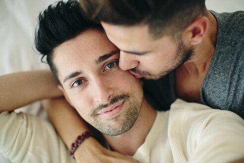 Portrait of male couple, man kissing partner on cheek - CUF05569