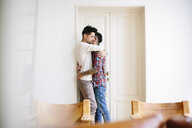 Male couple, at home, hugging - CUF05578