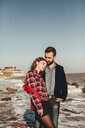 Romantic mid adult couple standing on beach, Odessa Oblast, Ukraine - ISF01425