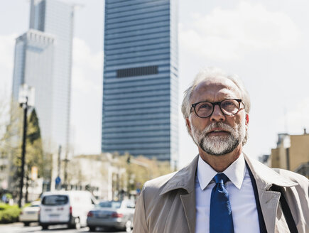 Portait of mature businessman in the city - UUF13692