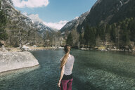 Rear view of young woman looking out over lake, Lombardy, Italy - CUF05928