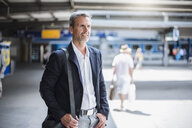 Mature businessman arriving at train station - CUF05934