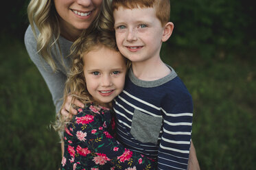 Portrait of girl, brother and mother hugging - CUF05967
